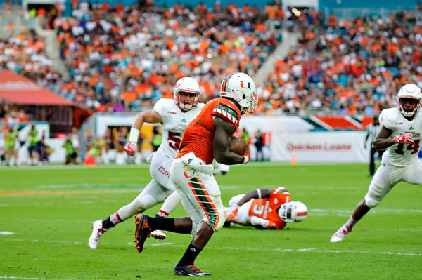 Hurricanes RB, Joe Yearby, heads up field after catching a pass from Brad Kaaya