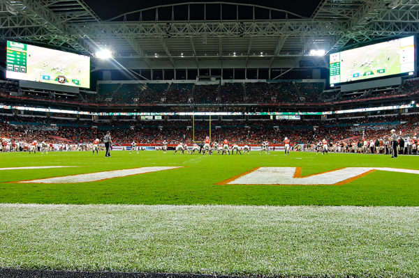 The Miami Hurricanes line up under the bright likes of Hard Rock Stadium