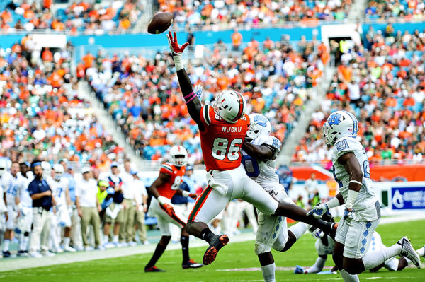 The pass from Brad Kaaya is just out of the reach of Hurricanes TE, David Njoku