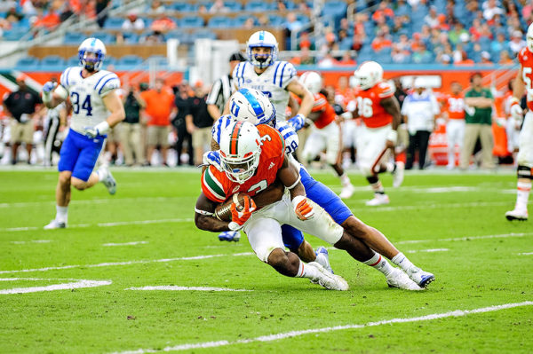 Stacy Coley tries to spin out of a tackle
