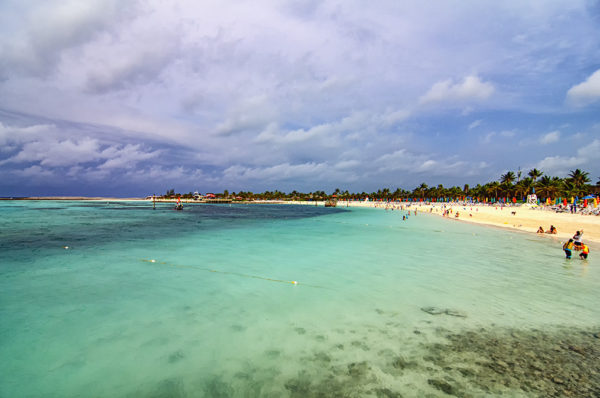 Cruisers aboard the Disney Magic frolic on the beaches and water at Castaway Cay
