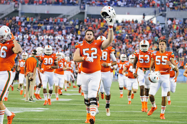 KC McDermott, acknowledges the crowd as the Hurricanes run onto the field