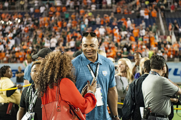 Former NFL great, Eddie George, is on hand for the trophy presentation