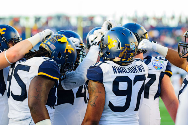 West Virginia Defensive line huddles up before the game