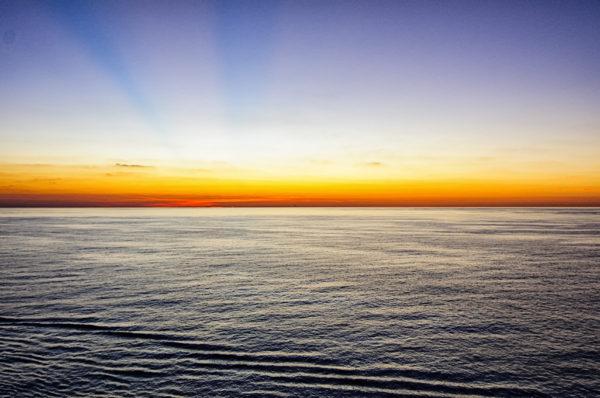 The colors of sunrise over the ocean near the Bahamas