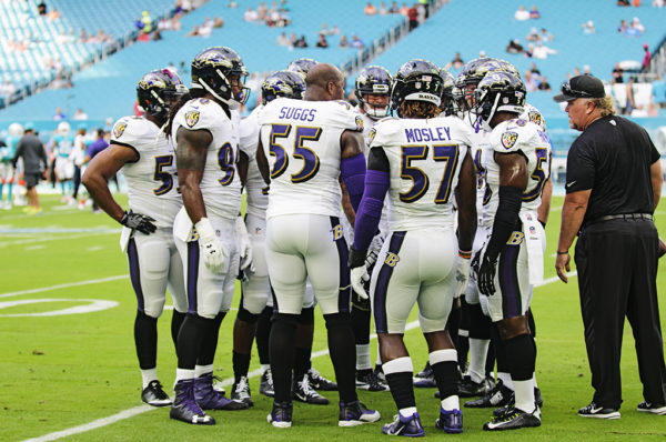 Ravens LBs have a quick huddle during warm ups