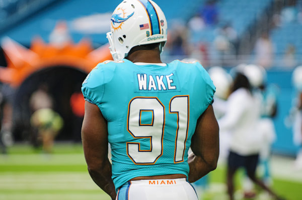Cameron Wake, #91, gets ready to line up for drills