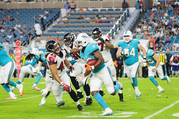Dolphins RB, #32 Kenyan Drake, turns the corner against the Falcons defense