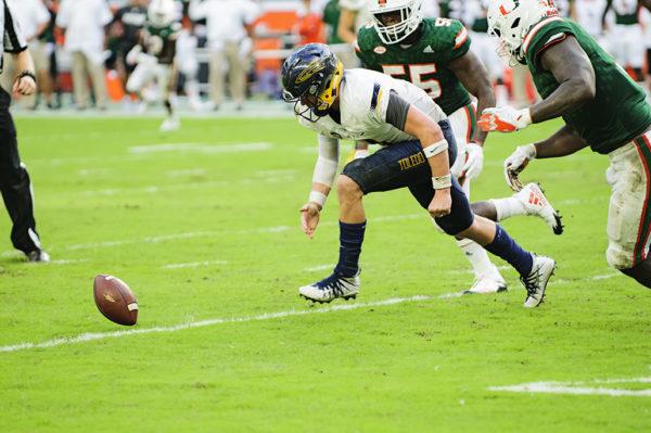 Logan Woodside fumbles the football