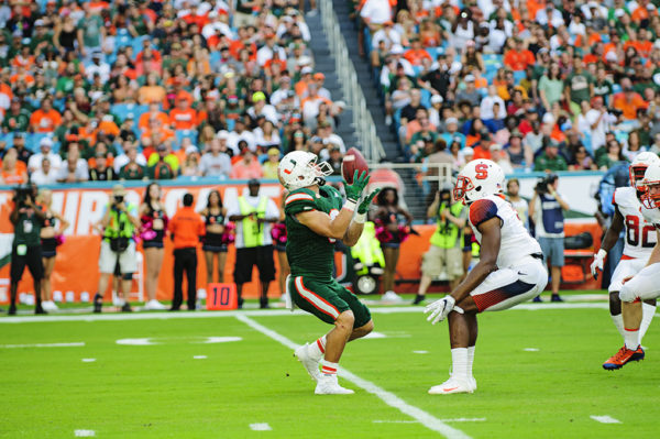 Braxton Berrios catches a punt with pressure in his face