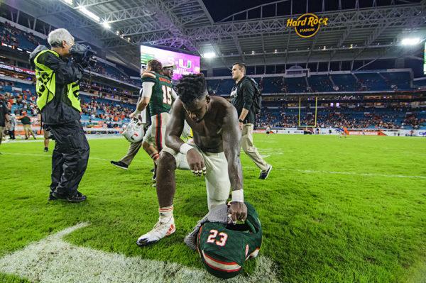 Christopher Herndon kneels after the game