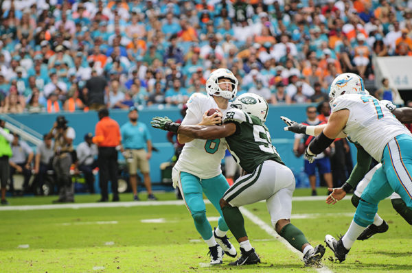 Jay Cutler (6) gets hits by Darron Lee (58)