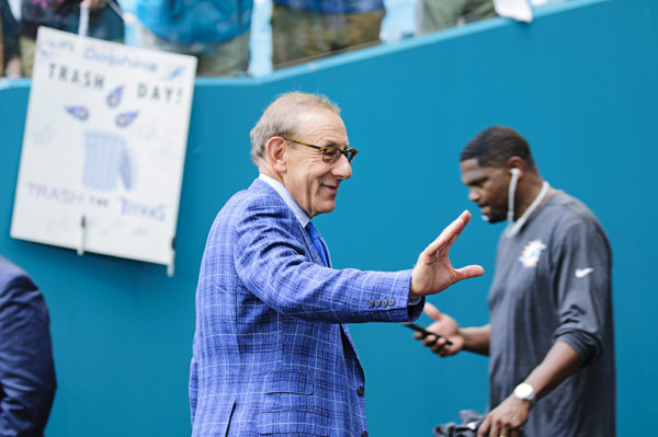 Miami Dolphins owner, Stephen Ross, waves to fans