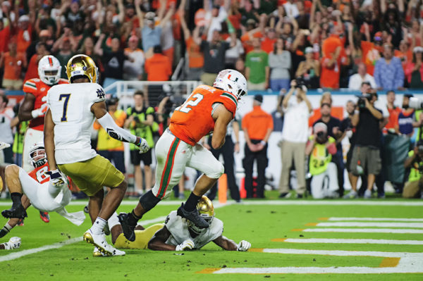 Malik Rosier (12) rushes in for a touchdown