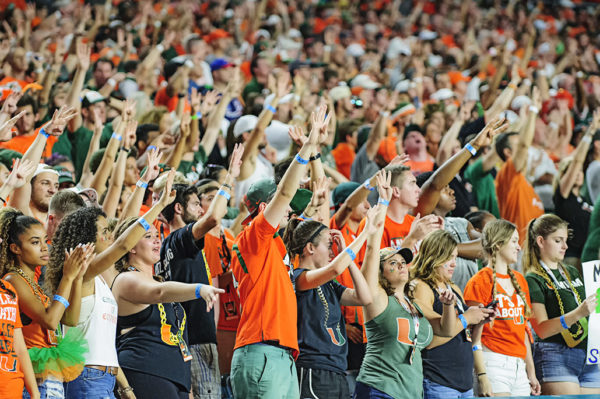 Hurricane fans hold four fingers in the air for the 4th quarter