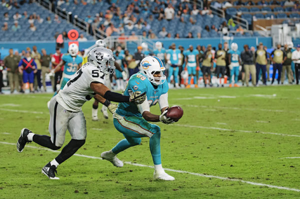Dolphins tight end Julius Thomas (89) hauls in a pass from Jay Cutler