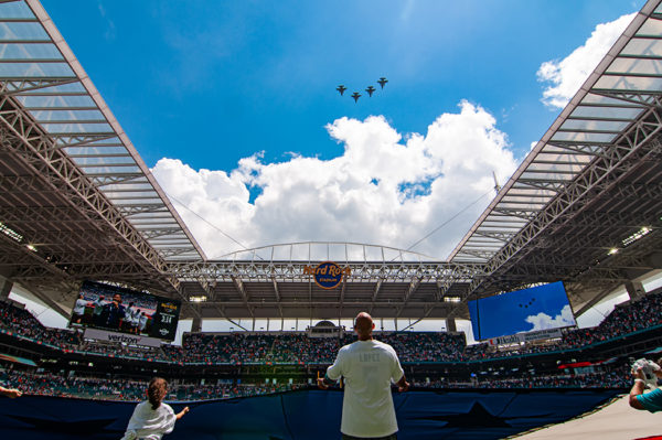 Fighter jets perform a flyover during the national anthem