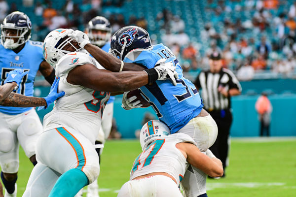 Tennessee Titans running back Dion Lewis (33) tries a stiff arm as he is being tackled