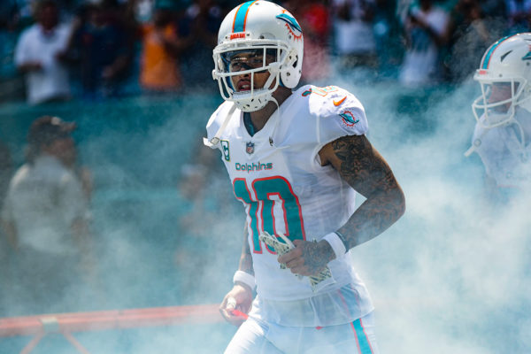 Miami Dolphins wide receiver Kenny Stills (10) emerges from the smoke