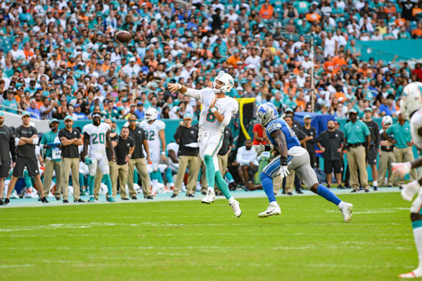Miami Dolphins quarterback Brock Osweiler (8) throws a pass on the run