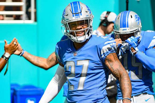 Detroit Lions free safety Glover Quin (27) is all smiles as he walks onto the field