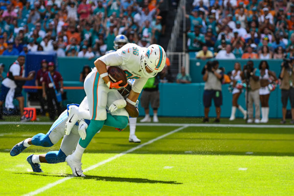 Miami Dolphins tight end Mike Gesicki (86) gets tackled by Detroit Lions strong safety Quandre Diggs (28)