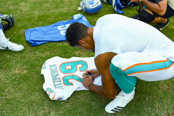 Miami Dolphins free safety Minkah Fitzpatrick (29) signs his jersey after the game