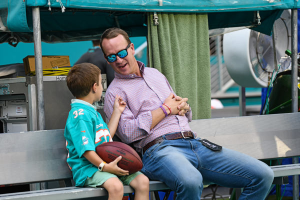 NFL great, Peyton Manning, spends some quality time before the game with his son