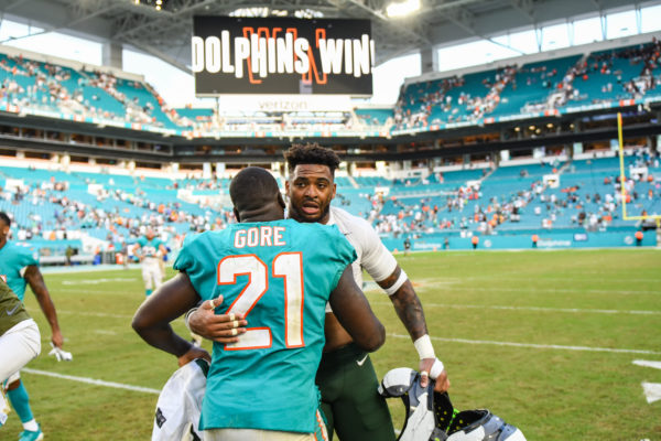 Miami Dolphins running back Frank Gore (21) and New York Jets strong safety Jamal Adams (33) meet after the game