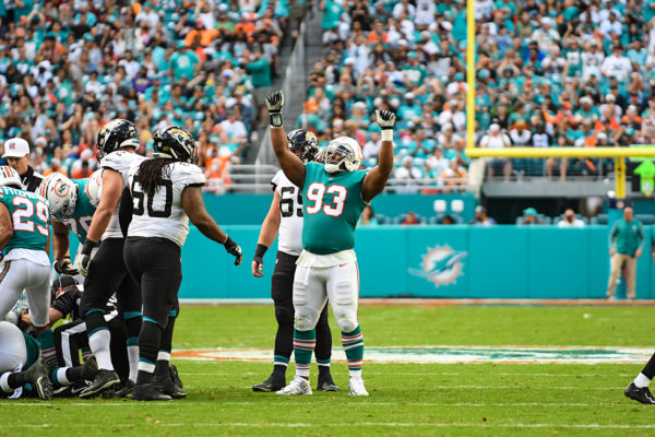 Miami Dolphins defensive tackle Akeem Spence (93) celebrates a fumble recovery