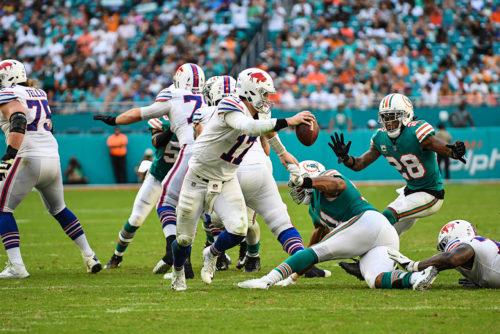 Buffalo Bills quarterback Josh Allen (17) evades a defender