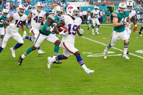 Buffalo Bills wide receiver Isaiah McKenzie (19) runs a kickoff back