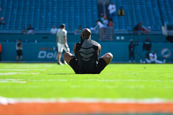 Jacksonville Jaguars running back Leonard Fournette (27) stretching