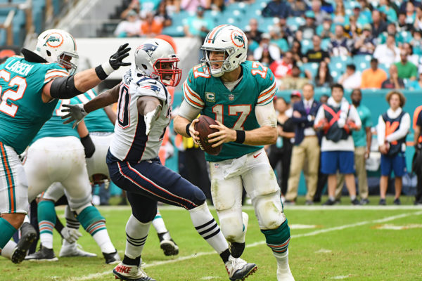 Miami Dolphins quarterback Ryan Tannehill (17) scrambles