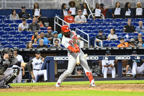 Philadelphia Phillies center fielder Andrew McCutchen (22) hits a triple in the 14th inning