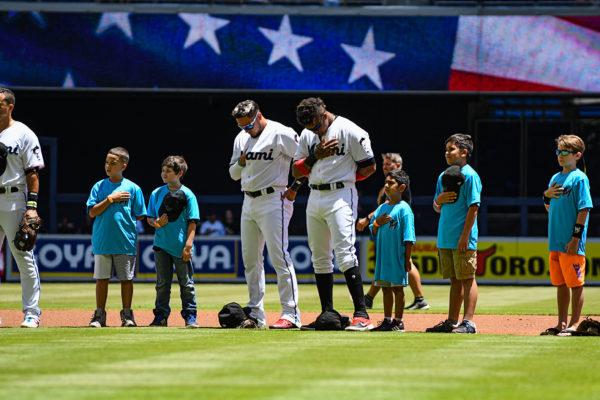 Miami Marlins shortstop Miguel Rojas #19 and Miami Marlins second baseman Starlin Castro #13