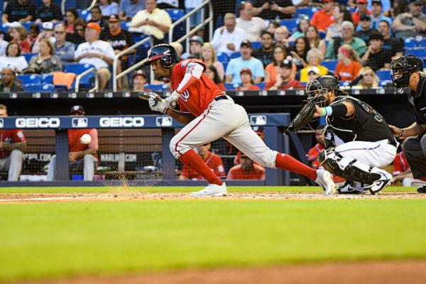 Washington Nationals center fielder Victor Robles #16 lays down a bunt