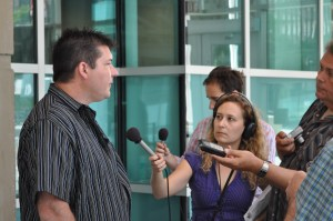 Darcy Allen answering questions at Calgary courthouse July 2012
