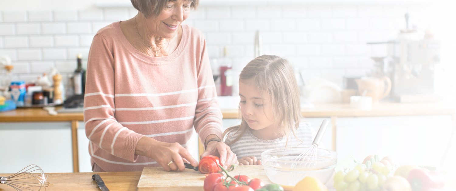 Grandmother teaching granddaughter to cook
