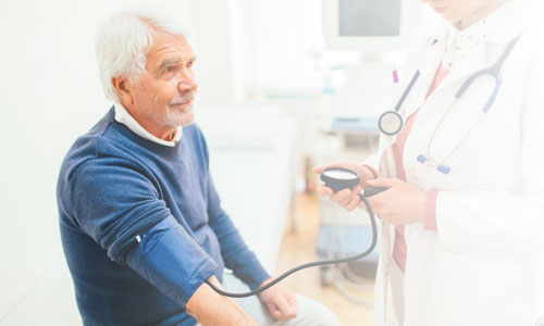 Elderly man getting blood pressure checked