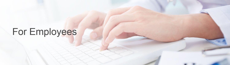 Hospital employee using laptop to log time