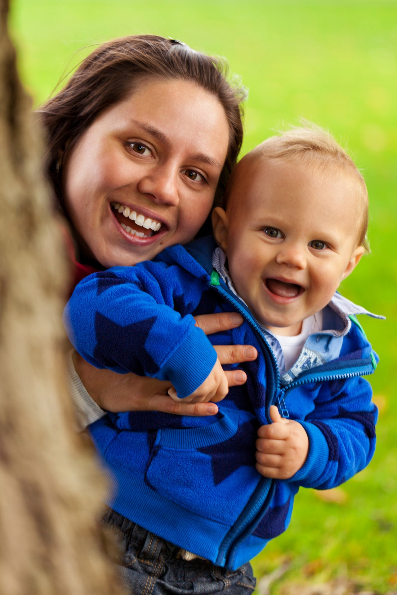 woman and baby smiling