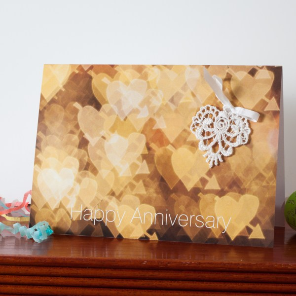 Anniversary greetings card with lace heart keepsake