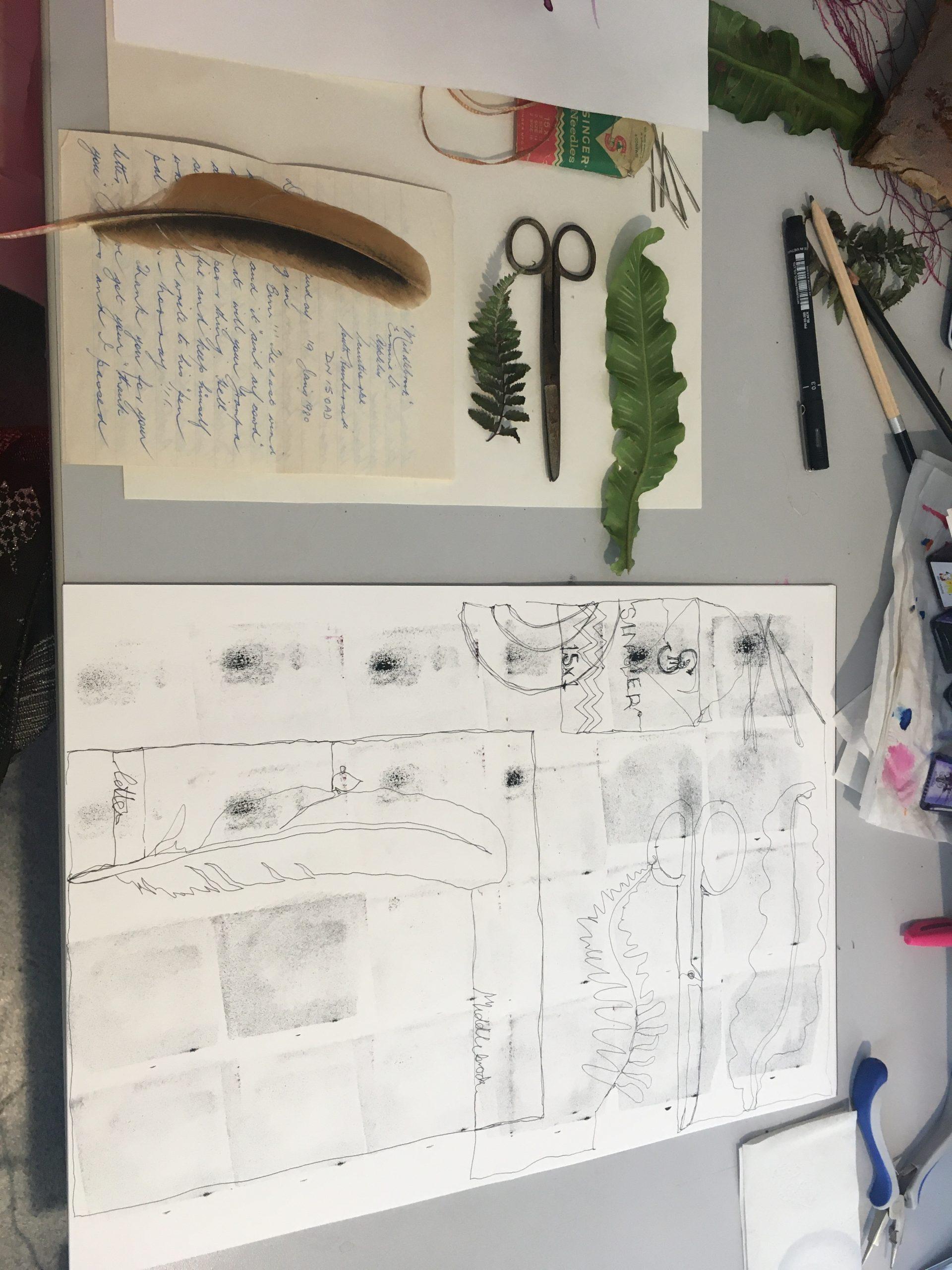 A photograph of a textile design sketchbook page