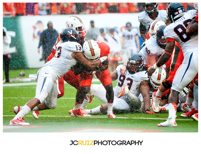 Miami RB #25, Dallas Crawford, rushes into the endzone for a touchdown