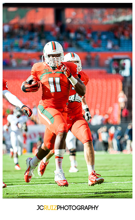 Hurricanes defensive player #11, David Gilbert, runs for a touchdown after a fumble recovery