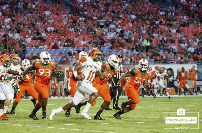 FAMU QB Damien Fleming runs away from Miami Hurricanes defense