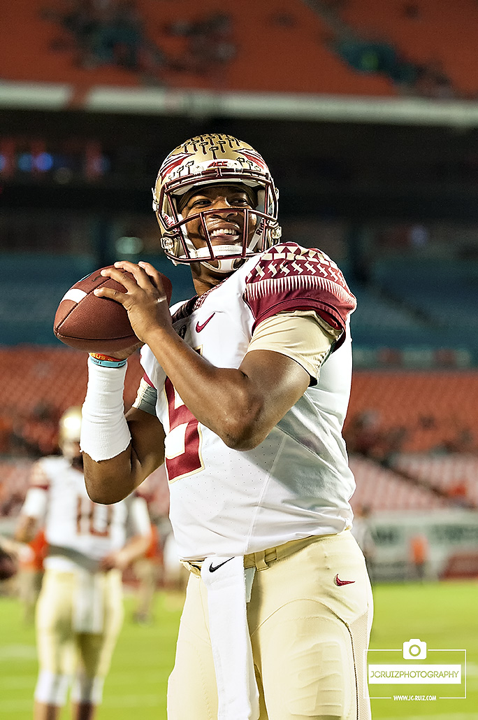 Florida State QB #5 Jameis Winston is all smiles warming up