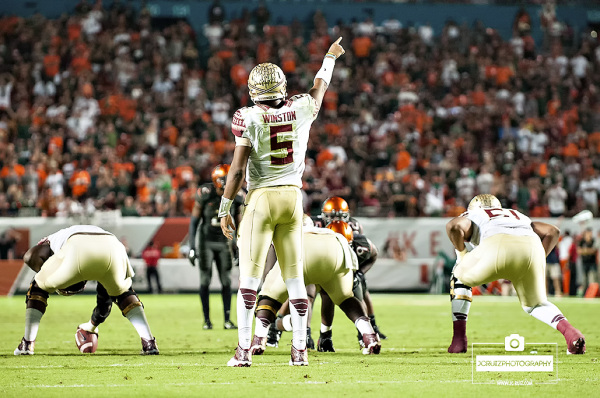 Florida State QB #5 Jameis Winston directs his WRs in a pre-snap audible