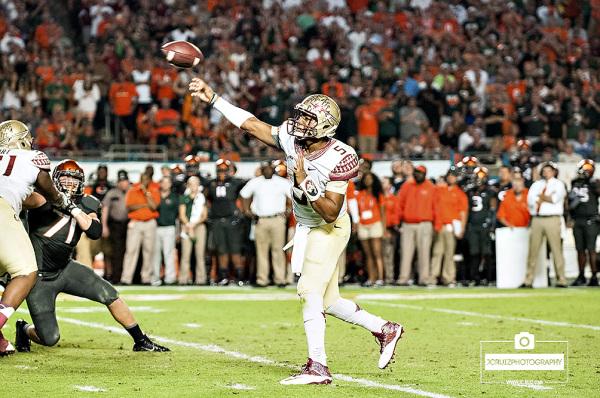 Florida State QB #5 Jameis Winston throws a pass